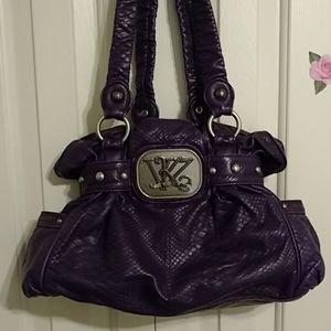 Kathy Van Zeeland purple satchel